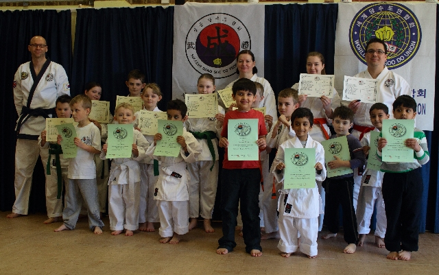 Group shot of members with their certificates